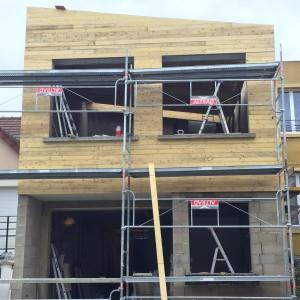 Mise en place de la volige sur la façade